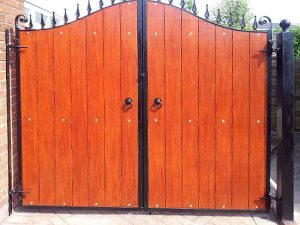 wrought iron and timber drive gate